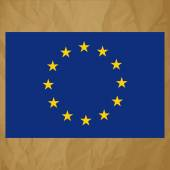 Flag of European Community on a crumpled paper brown background