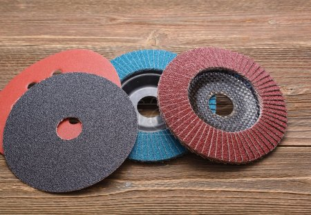Abrasive wheels on wooden background
