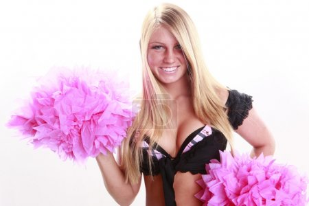 Photo for Young woman cheerleader and pink pom-poms - Royalty Free Image