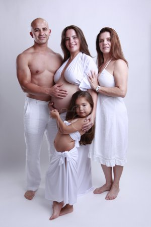 family with a pregnant woman and daughter