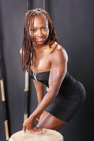 Cute and fit black girl with drum