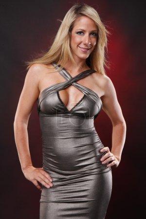 Cute blonde girl in silver dress...