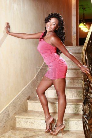 African American girl poses at a stairway