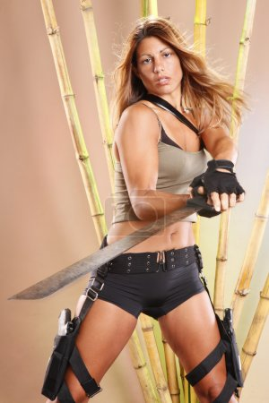 Blonde girl with a machete