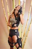 Blonde girl with a gun