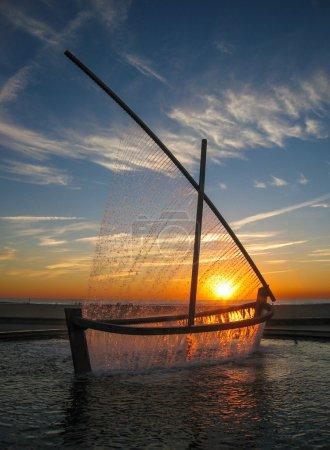 Fountain - sailboat at sunrise