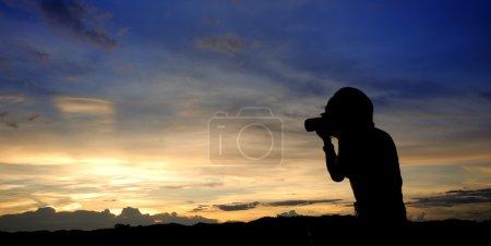 Woman taking photograph