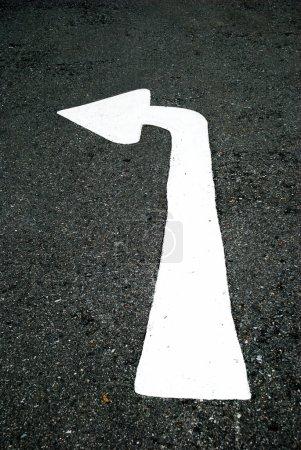 Turn-left arrow on street