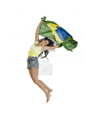 Young Brazilian woman support with flag