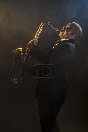 Photo for African American Saxophonist playing on instrument - Royalty Free Image
