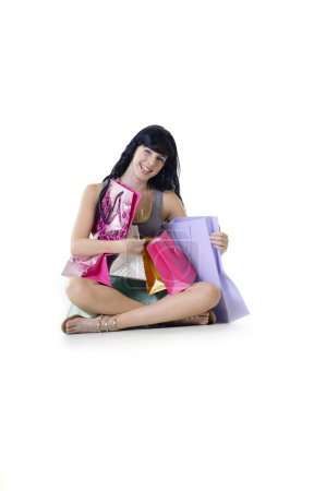 shopaholic surrounded by bags