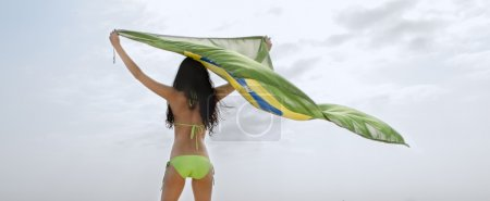 young woman with Brazil flag