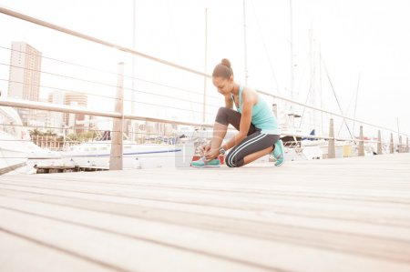 Young attractive runner girl enjoying a morning exercise routine