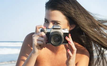 Young attractive woman with camera
