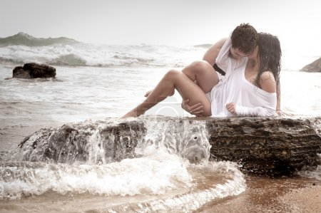 Young beautiful  in love couple having fun flirting at the beach