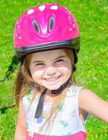 Girl wearing bicycle helmet