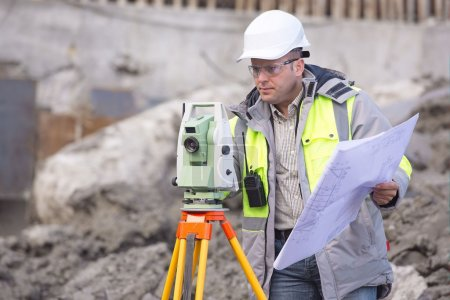 Surveyor At Consruction Site