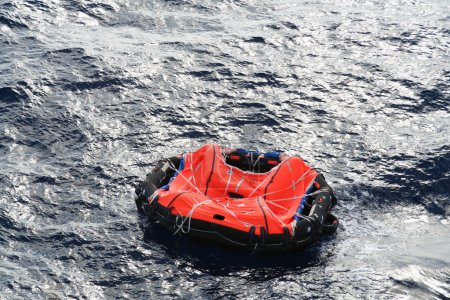 A life raft drifts in mid ocean