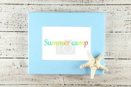 Blue wooden frame with text