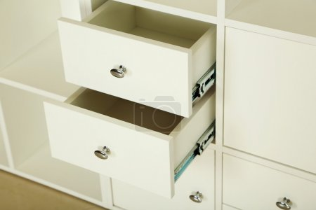 Photo for White wooden open boxes, white chest of drawers - Royalty Free Image