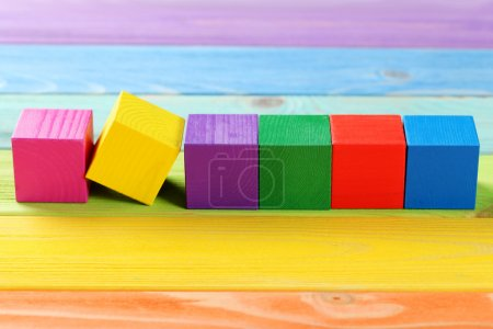 Photo for Colorful wooden toy cubes on a colorful wooden background - Royalty Free Image
