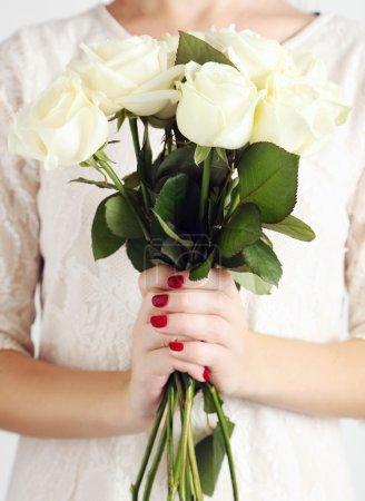 Female hands holding  roses