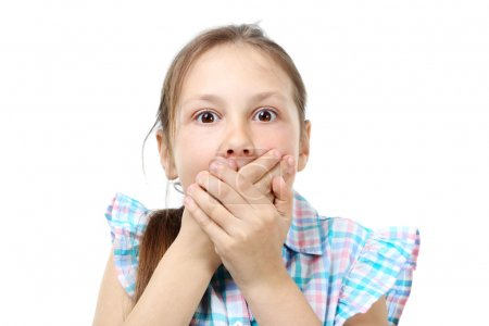 girl holds her mouth in silence