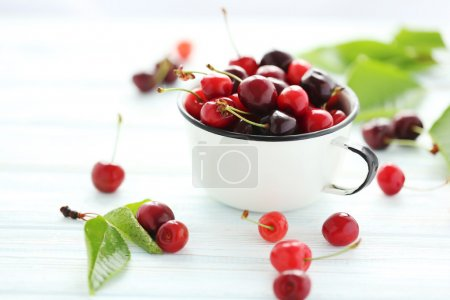 Ripe cherries in mug