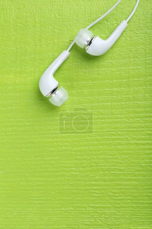 White headphones on a green table