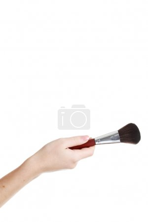 Female hand with brush for make up