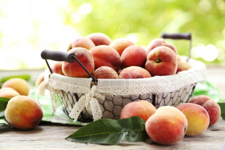 Sweet peaches in basket