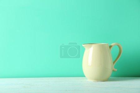 Beige ceramic jug