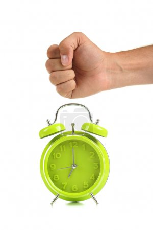 Green alarm clock with male hand