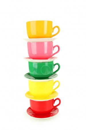 Photo for Colorful cups and saucers on white wooden background - Royalty Free Image