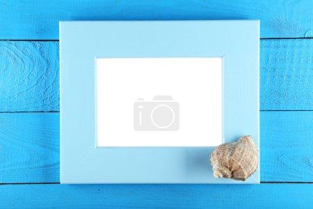 Wood frame and seashell