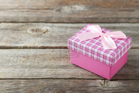 Photo for Beautiful gift box on grey wooden background - Royalty Free Image