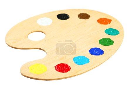Wooden art palette with paints