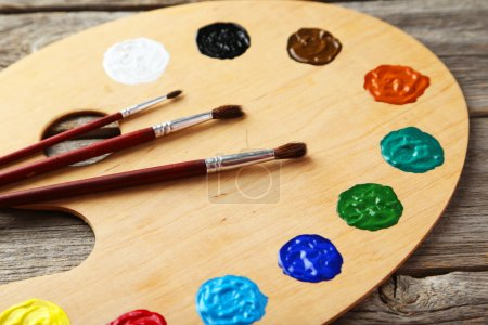 Wooden art palette with paint