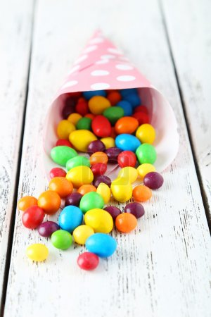 Candies on wooden background