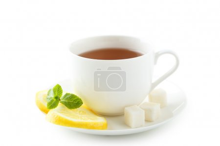 Photo for Cup of tea with mint and lemon isolated on white - Royalty Free Image