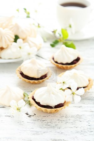 Photo for French meringue cookies in tartlet on white wooden background - Royalty Free Image