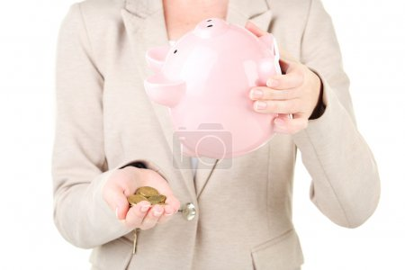 Shaking out piggy bank