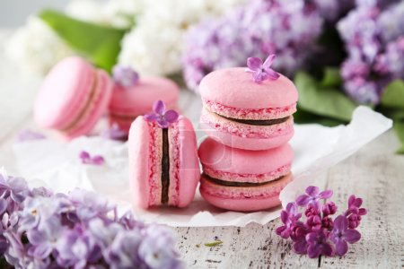 Photo for French pink macaroons with lilac flowers - Royalty Free Image