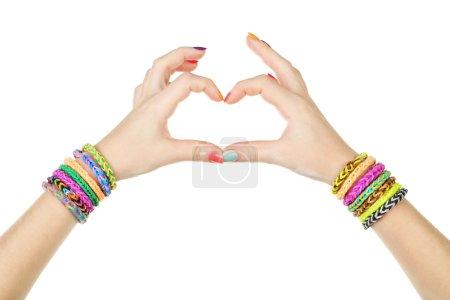 Female hands in shape of heart