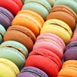 French colorful macaroons background, close up...