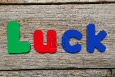 Luck word made of colorful magnets