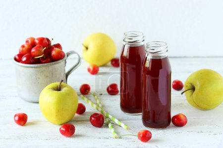 Glasses  of cherry juice with apples
