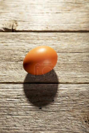 Chicken egg on table