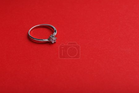 Diamond ring on a red background
