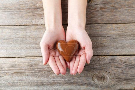Photo for Woman's hands with chocolate heart - Royalty Free Image